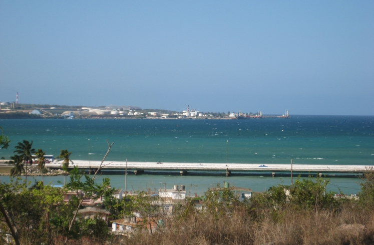 The Bay of Matanzas with coastal highway and Petrocaribe-funded oil processing facility beyond.